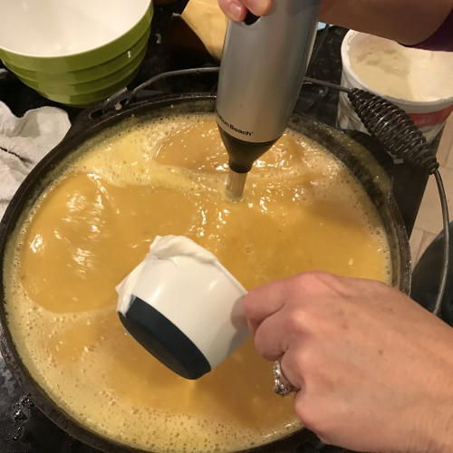 Using an immersion blender, puree mixuture. Add sour cream when bisque is smooth.