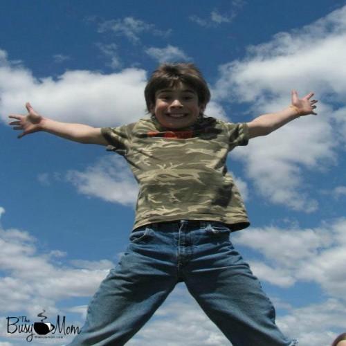 Sam on trampoline square with logo