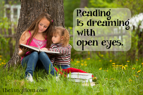 http://www.dreamstime.com/stock-image-children-reading-book-summer-park-image25167761