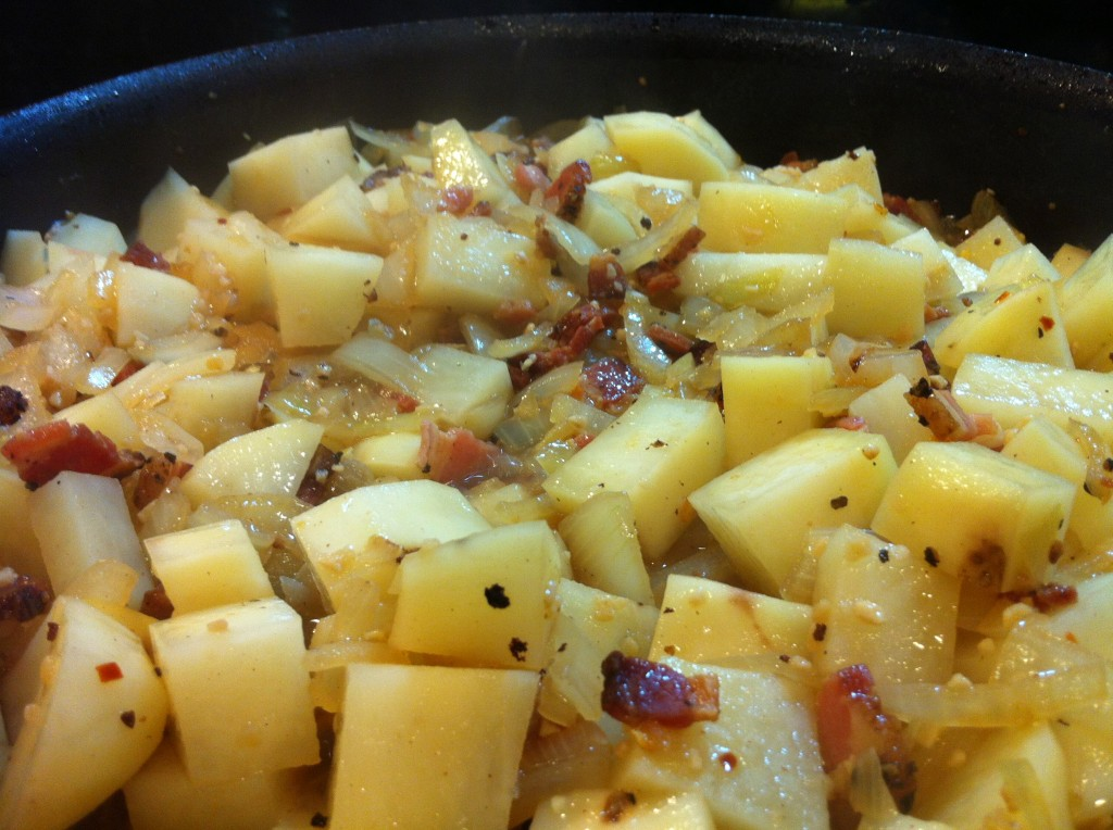 Saute potatoes with onions and garlic until they look the way you like 'em